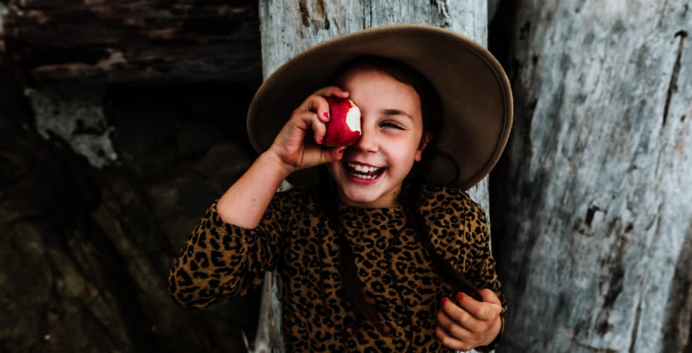 Ashley Marston photography, photo of Ashley's daughter with an apple.